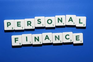 Personal finance spelled out in dark green and white scrabble letters